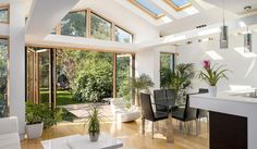 An imaginative loft conversion and an extension at ground level transformed this drab former council house, and doubled its value. Council House Renovation, Home Renovation, Raked Ceiling, House Extensions, Kitchen Extensions, Roof Light, Property Prices, Moving House, Create Space