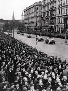 """Anschluss (conquest of Austria) 1938: German motorized troops roll in the streets of Vienna. Austria fell thanks to a Nazi domestic conspiracy led Arthur Seyss-Inquart. Austria became a province of the Reich under the name """"Ostmark."""" Seyss-Inquart became the first Governor of the new province (after the war, he was hanged for war crimes)."""