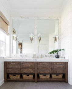 love the contrast of wood/white marble - two separate mirrors for the jack & jill sinks - take out vanity lighting fixtures and replace with either overhead lighting