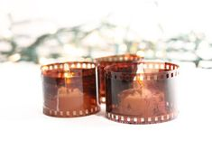 Having an Oscar party or a memory-themed birthday bash?  Take some of those old photo negatives you have hanging around and wrap them in a circle around LED tea lights.