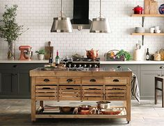 I love the Williams-Sonoma Kitchen on williams-sonoma.com/ The perfect uncluttered combination of european flair, modern elects and rustic charm.