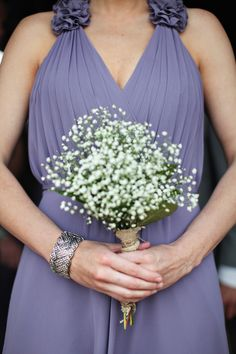 Simple bouquet with beautiful pale purple bridesmaid dress at this modern Chicago wedding, photos by The Rasers | via junebugweddings.com