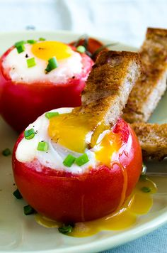 Egg stuffed tomatoes baked in oven. These are like tomato bombs loaded with eggs. Make it as an appetizer or breakfast food. Nobody can resist that runny yolk!   giverecipe.com   #egg #tomatoes