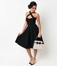 Penny was born a Pin-up, dames. An all black flare fresh from Collectif in a striking 1950s reminiscent vintage dress design, the Penny Flare is a glamorous rockabilly go-to! Crafted in supple stretch bengaline that clutches curves, with a cross halter ne