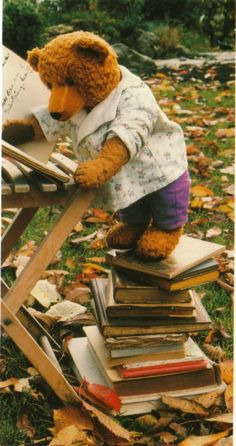 ...he played the day away even putting teddy on a stack of books at the table...