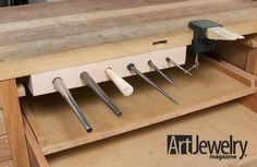 I like the concept, but my real estate in front of my bench pin is too precious, so along side of a bench leg might work better. Build an Under-bench Mandrel Holder Metal Jewelry, Jewelry Art, Jewelers Workbench, Jewellers Bench, Tool Bench, Jewelry Making Tools, Tool Storage, Metal Art, Metal Working