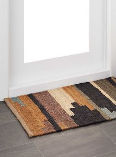 A natural jute weave with a colour block design inspired by artisanal patchwork. The perfect addition to this season's Bohome decor.    Irregular textured weave   60 x 90cm   Other size also available