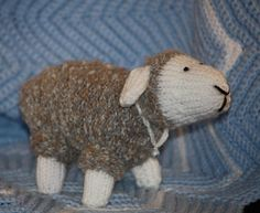Hand Knitted Gray Sheep Toy with Tiny Bell.. $25.00, via Etsy.