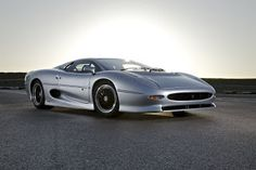 The Jaguar XJ220 is a mid-engined cool sports car produced by Jaguar in accord with Tom Walkinshaw Racing as Jaguar Sport amid 1992 and 1994...