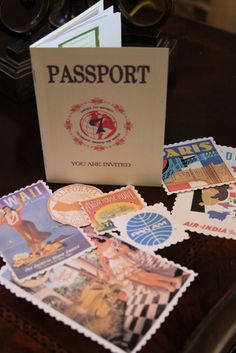 party invitation that looks like a passport.  especially love the vintage travel ads and airline stickers!