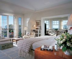 pretty master bedroom with sitting room and tranquil views