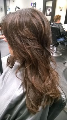 Rich dark brown hair color balayage warm fall color with haircut and layers and curls