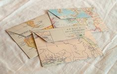 Maps made into envelopes!  CUTE!  Idea:  Store trip collectibles in maps made of areas traveled!!!!!