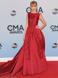 She knows how to make an entrance! Taylor Swift lived up to the title of her last album Red as she arrived in a huge scarlet gown at the CMA...