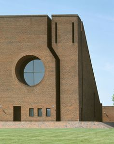 The Church lies in a 1970's suburb of Arhus. In relation to the nearby apartment blocks, the church asserts itself not through size but through its weight and characteristic form. Its massive effect is accentuated by the deep cuts which separate the be...
