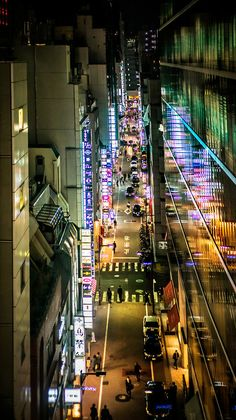 I love going to Ginza at night. It's bright, colorful, and extremely clean. Well, all of Tokyo is clean, but especially this part. As I went down one of the little streets, I saw this high bridge up seven or eight stories. I climbed up through one of the nearby stores and tried to work my way back around to the right spot and eventually found it. - Tokyo, Japan - Photo from #treyratcliff Trey Ratcliff at http://www.StuckInCustoms.com