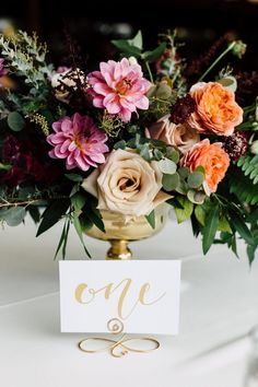 centerpiece and table number - photo by Plum and Oak http://ruffledblog.com/a-california-garden-wedding-with-romantic-florals