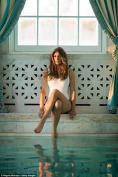 Bathing beauty: Melania poses in the pool.Asked to reveal her secret to a happy marriage, she said simply: 'Separate bathrooms.