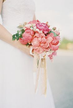 For a garden-inspired wedding, Columbia, South Carolina-based florist Fern Studio created a classic coral bouquet filled with charm peonies and green accents. Coral Peony Bouquet, Coral Peonies, Peony Bouquet Wedding, Bride Bouquets, Floral Bouquets, White Peonies, Wedding Flower Photos, Spring Wedding Flowers, Beach Wedding Reception