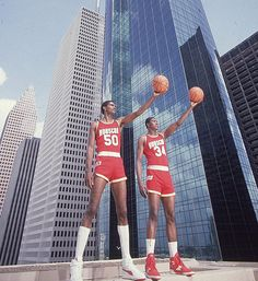 "This Day In NBA History: 1986 - Ralph Sampson, who teamed with Hakeem Olajuwon in the ""Twin Towers"" alignment for the Houston Rockets, catches an inbounds pass with one second left and bounces in a. Basketball Legends, Sports Basketball, Basketball Players, Basketball Memes, Basketball History, College Basketball, Sports Teams, Basket Nba, Hakeem Olajuwon"