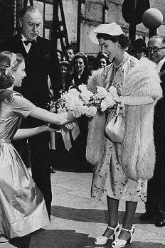 1951 Receiving a bouquet of flowers