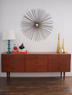 starburst accent above a mid-century credenza - I want this in a future dining room! Mid Century House, Mid Century Style, Mid Century Design, Mcm Furniture, Dining Room Furniture, Furniture Design, Mid Century Modern Decor, Mid Century Modern Furniture, Mid Century Credenza