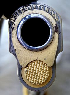 I like the idea of an engraving on the business end of a pistol, I wouldn't go with this phrase though.