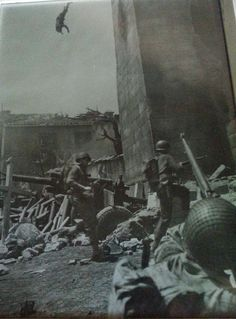 Sniper falling from his position after being shot. Italy 1944.