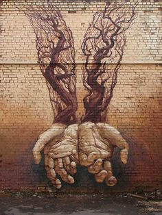 ^Ukrainian artists Alexander Grebenyuk and Fox recently stopped by Kiev to paint for the Gogol Fest Event. Using an earthy color scheme, the duo painted this beautiful and large-scale pair of hands with tree roots. (Source: Street Art News)