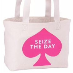 NwT Kate spade tote New with tags Kate spade seize the day tote. Pink spade symbol on canvas with red handles kate spade Bags Totes
