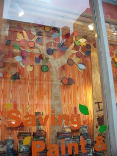 Home Depot window display...they used a piece of ply wood, paint lids and paint samples to make the leaves.