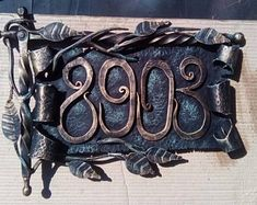 Hand forged home decor, wedding decor, metal/iron gifts by ForgedCommodities House Number Plaque, House Numbers, Barn Door Handles, Address Numbers, Bronze Patina, Fence Art, Unusual Homes, Home Signs, Cool Items