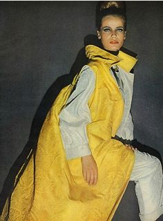 1963 Veruschka in white silk palazzo pajamas and yellow coat by Donald Brooks for Townley, photo David Bailey, Vogue
