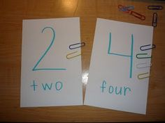 I wrote the number and number word on a large index card. I plan on laminating these. The kids just match the paperclips to the card. I love this because it builds in some fine motor as well.