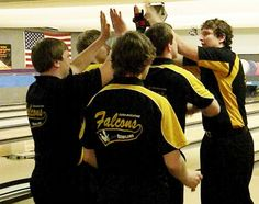 The Louisa-Muscatine boys bowling team congratulates junior Beau Hahn after he completed a string of seven strikes during a Baker game Monday at the Class 1A state tournament at Plaza Lanes in Des Moines.