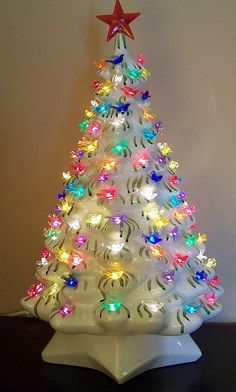 White Ceramic Christmas Tree. My Mom made one in green & it was a lot prettier. This gets me teary!