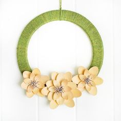 wooden spoon flower wreath using green jute twine wrapped around a flat wood form