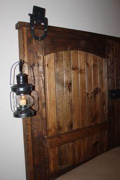 How To Build A Rustic Barn Door Headboard :: Hometalk  Good idea to hang a light like that