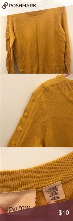 Anthropologie sweater Cute mustard yellow sweater.  Hits just below the butt and has button details on one shoulder. Anthropologie Sweaters Crew & Scoop Necks