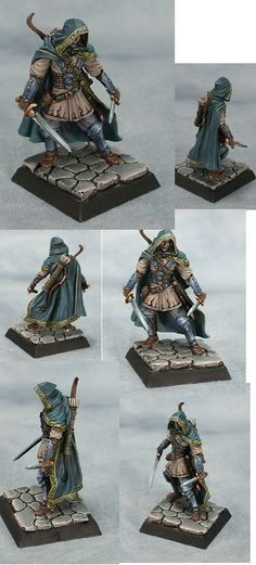 Not flashy or complicated. This is how I would like all of my tabletop minis to look. The NMM is well executed, the cloth gives a real feeling of movement, and the freehand work is simple but very effective.