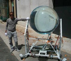 GIANT MARBLE HARVESTS ENERGY FROM THE SUN AND MOON    This is a sun-tracking, solar energy concentrator. It's so sensitive to light that at night, it can even harvest moonlight and convert it into electricity.     The sphere is 35% more efficient than traditional photovoltaic designs!   This spherical lens solar generator uses a large water-filled glass ball to concentrate the sun's energy (by up to 10,000 times!) onto a small PV panel.