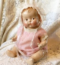 "Vintage All Composition Side Glancing Baby Doll 13"" with Clothes"