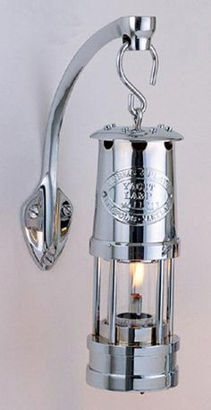 """These high quality lamps are proof that the lasting beauty of fine craftsmanship combined with the finest of materials is a winning combination. The Yacht Lamps represent the culmination of more than a century of practical use and development. Available crafted of solid cast and tooled brass, chrome plated or brass. Dimensions: 7"""" tall x 2-1/2"""" diameter. Oil container capacity: 2 oz. Burn time:  /- 12 hours with clean burning Weems"""