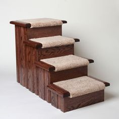 Premier Pet Steps Raised Panel Carpet Tread Made from Red Oak and able to hold over 300 lbs, these pet stairs are beautiful and functional! Using dog steps early in your dog's life can signific Dog Stairs For Bed, Dog Ramp For Bed, Pet Ramp, House Stairs, Carpet Treads, Stair Carpet, Affordable Carpet, Dog Steps, Pet Steps For Bed