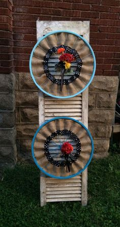 These are repurposed bicycle wheels, painted either blue or light blue, with burlap, and black & white ribbon and red and orange floral Bicycle Spokes, Bicycle Rims, Bicycle Wheel, Bicycle Parts, Black And White Ribbon, Black White, Diy Nursery Decor, Stage Decorations, Wreath Forms
