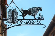 Villefranche de Confluent .  One of the most beautiful villages in France.  Walking through the streets of the village wrought iron sign