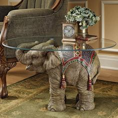 Lend exotic appeal to your living room or den with this charming coffee table, featuring a hand-painted elephant design and glass top.