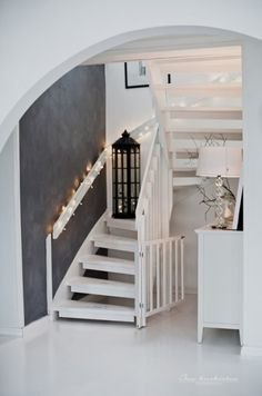 Grey and white stairs area. Nicely placed lights and lantern. Under Stairs Nook, Boho Deco, White Stairs, Scandi Home, Entry Hallway, Estilo Boho, House Entrance, Grey Walls, Beautiful Interiors