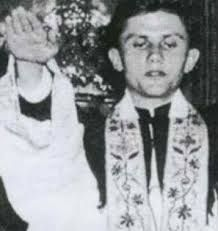 LIE: Pope Benedict the Nazi TRUTH: This photo is cropped to only show the right arm of the newly ordained Father Josef Ratzinger. The original ENTIRE photo shows both he and his brother Georg (who was ordained on the same day) extending both arms towards parishioners in their first priestly blessings. Someone with evil intent cropped it to make it seem as if he is giving a Nazi salute.