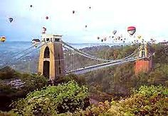 Bristol, UK. Host of the International Hot Air Balloon Fiesta every year - shown here flying across the Clifton Suspension Bridge.